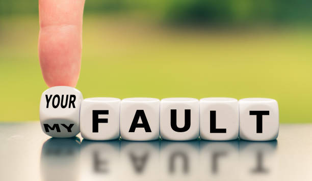 """Hand turns a dice and changes the expression """"my fault"""" to """"your fault"""", or vice versa. stock photo"""