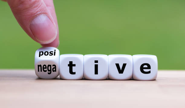 "Hand turns a dice and changes the expression ""negative"" to ""positive"". Hand turns a dice and changes the expression ""negative"" to ""positive"". positive emotion stock pictures, royalty-free photos & images"