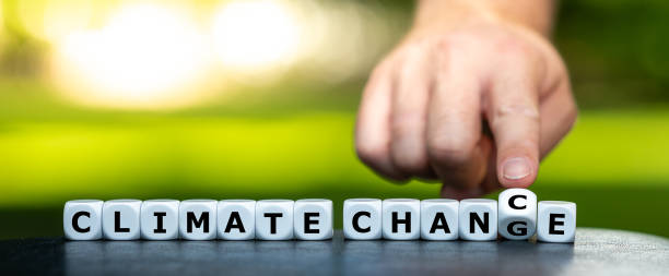 """Hand turns dice and changes the expression """"climate change"""" to """"climate chance"""". stock photo"""