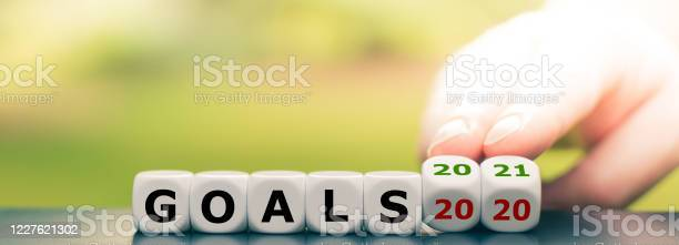 Hand Turns Dice And Changes The Expression Goals 2020 To Goals 2021 Stock Photo - Download Image Now