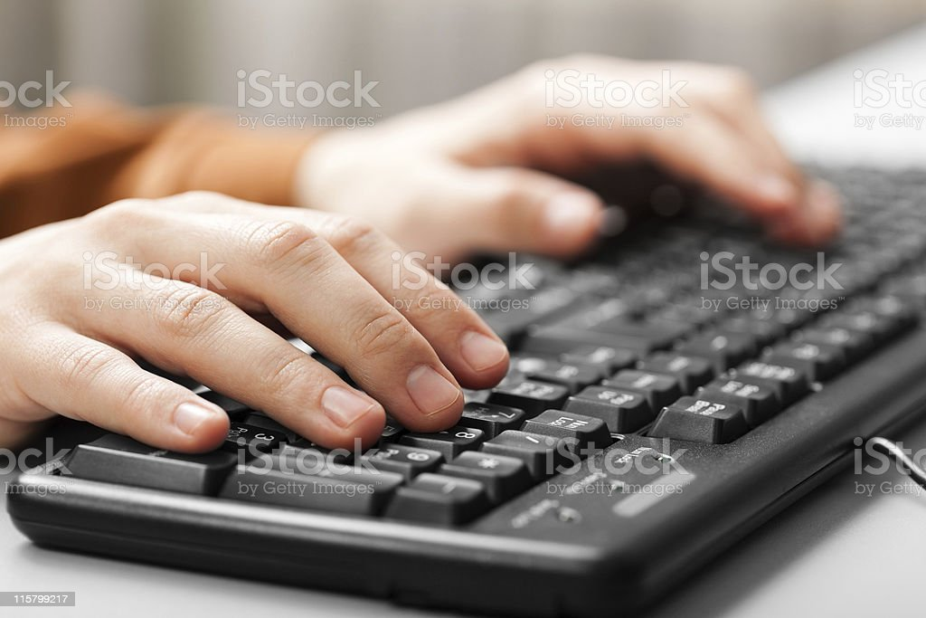 Hand typing computer keyboard royalty-free stock photo