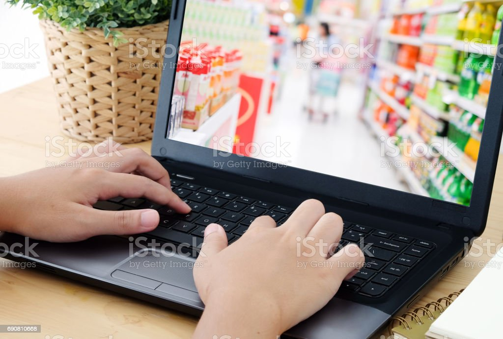 Hand Typing Laptop With Blur Supermarket On Screen Grocery ...