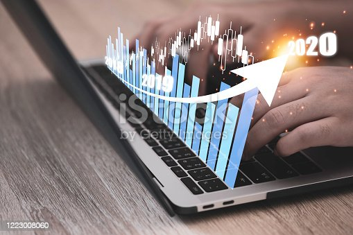 1051659174 istock photo Hand typing on computer laptop for analysis virtual fantasy technical graph. Stock investment business growth concept. 1223008060