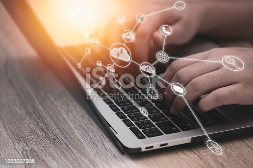 1049745706 istock photo Hand typing on laptop and virtual artificial intelligence with cloud technology transformation and internet of thing .Cloud technology management big data include business strategy , customer service. 1223007935