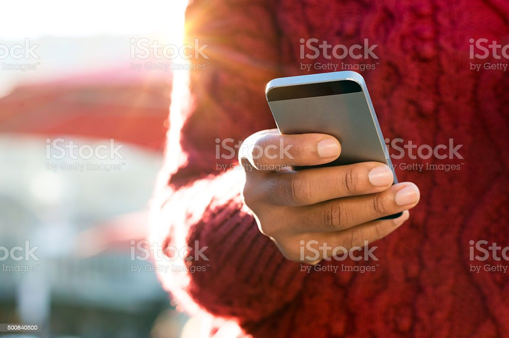 Hand typing on phone stock photo
