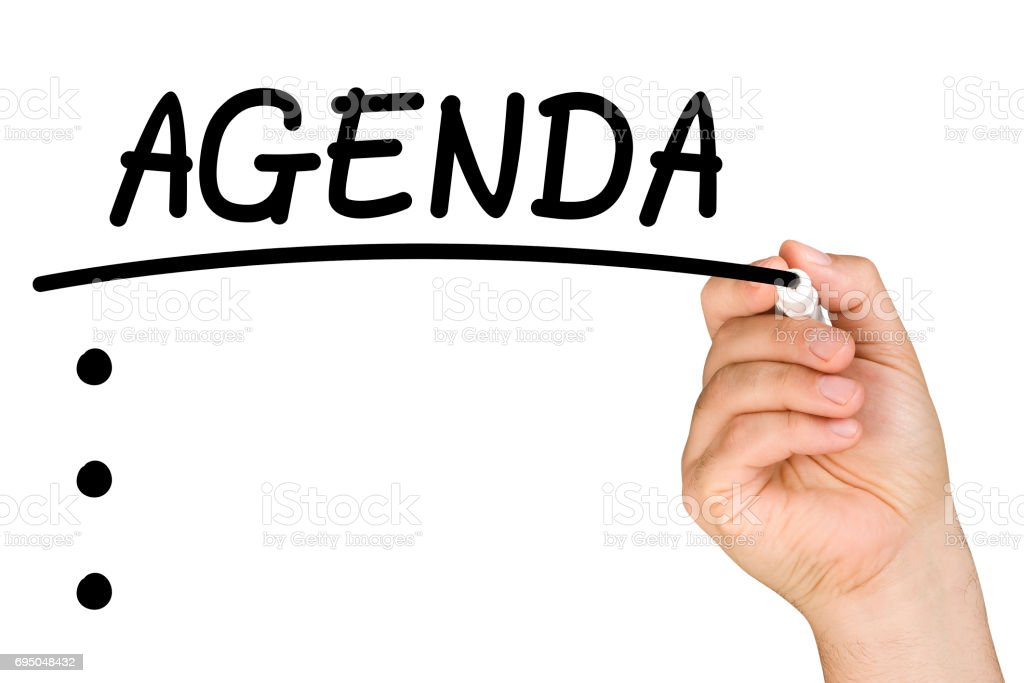 hand underlining agenda text with black felt tip or marker on a clear glass whiteboard isolated stock photo