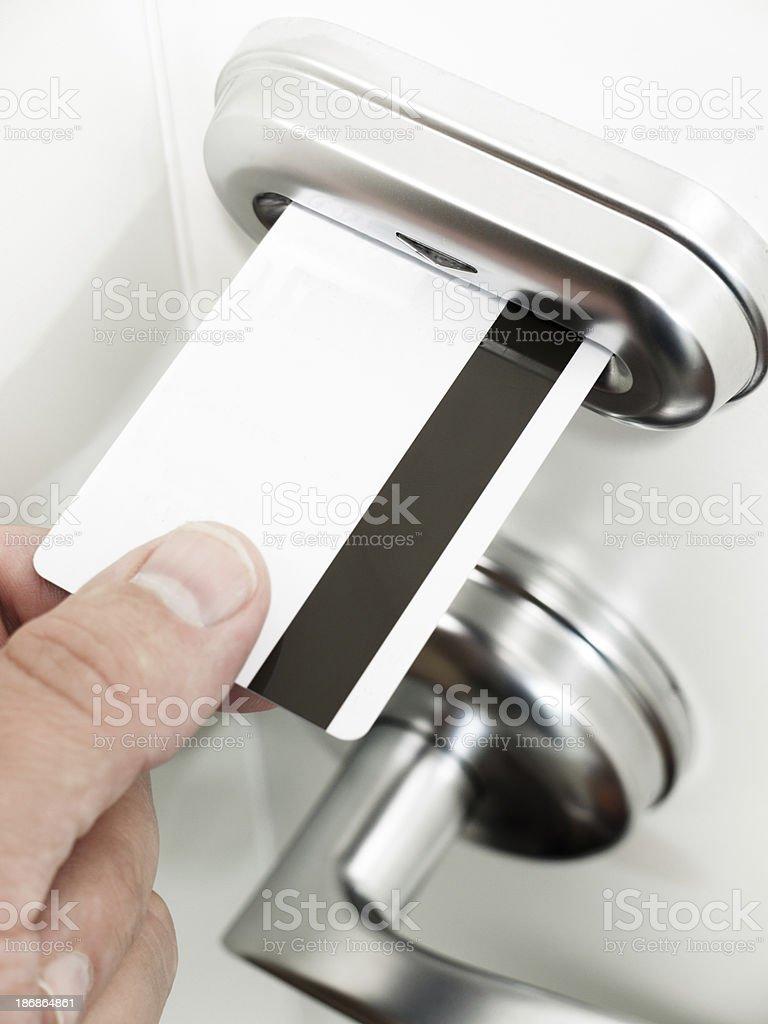 Hand Unlocking Electronic Keycard Door Lock royalty-free stock photo