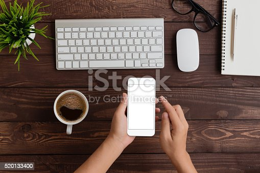 istock hand use phone blank screen top view 520133400