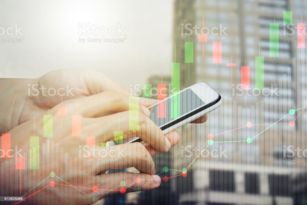 Hand use smartphone trading stock photo