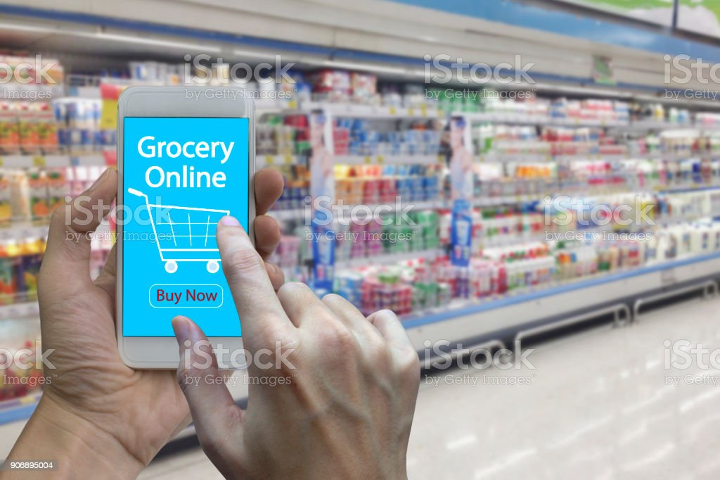 Hand use smartphone with grocery online stock photo