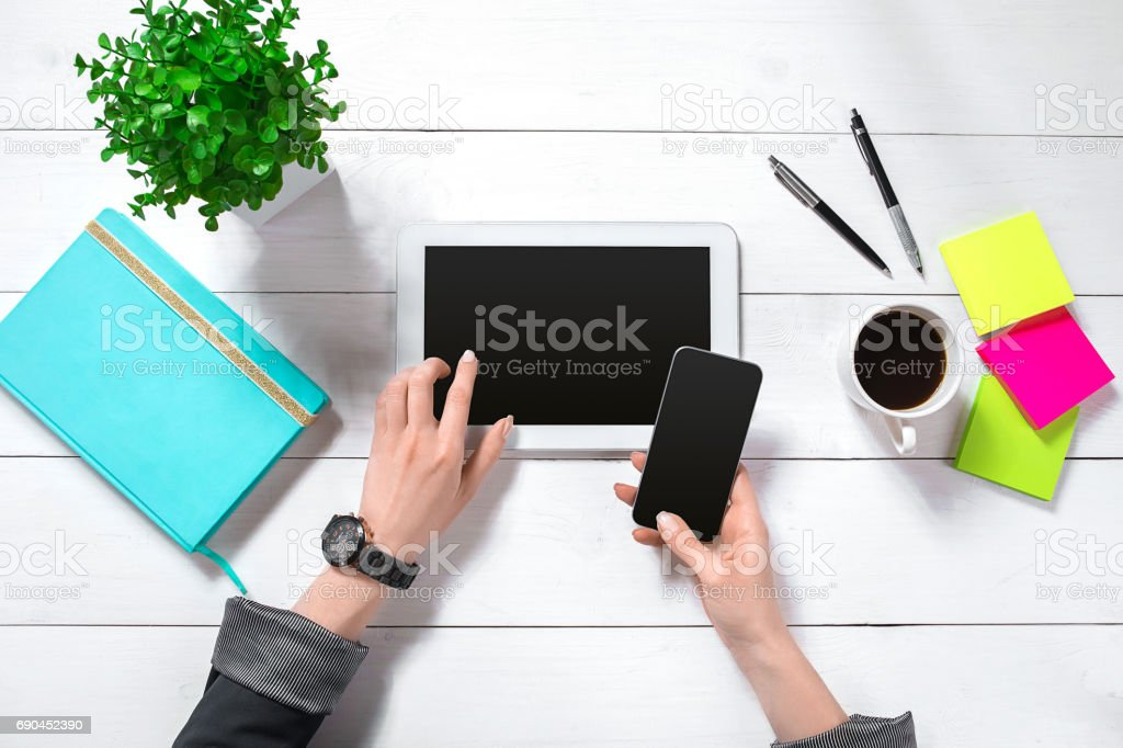 Hand use tablet on desk table top view stock photo