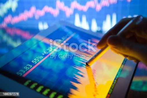 istock A hand using a digital tablet showing stock fluctuations 166097278