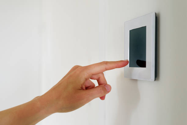 Hand using Air ventilation controller with display Hand using Air ventilation controller panel with display at home. Smart house system smart thermostat stock pictures, royalty-free photos & images