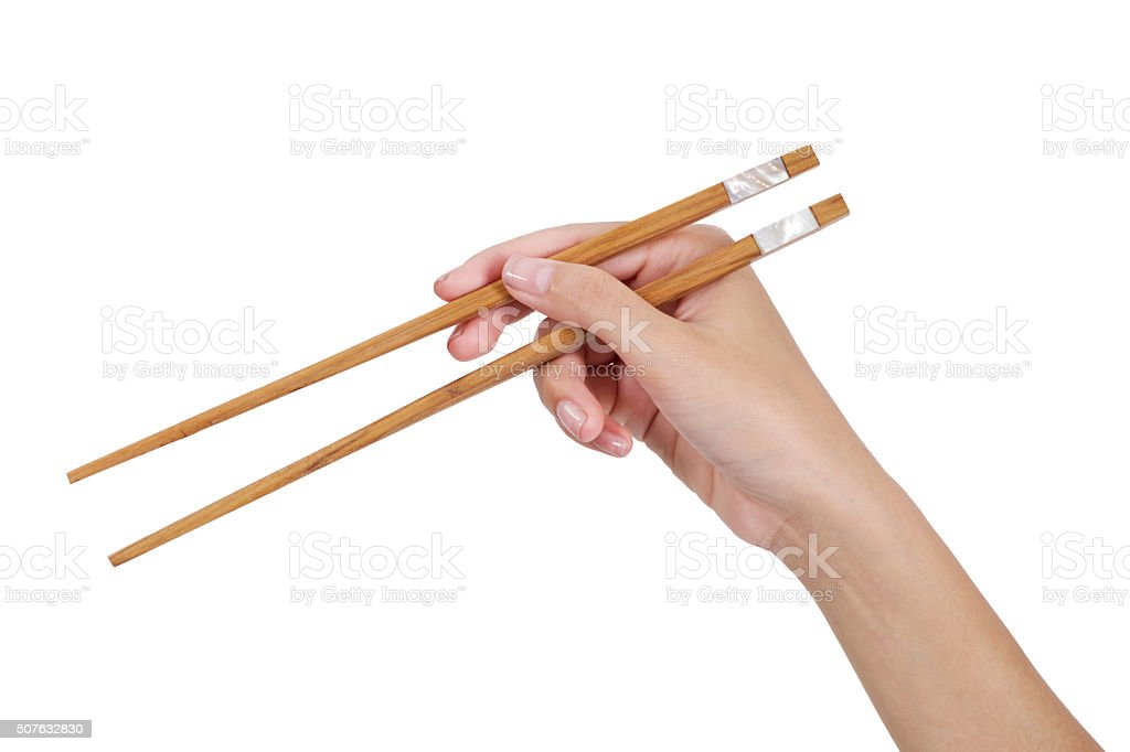 Hand Using Chopsticks. stock photo