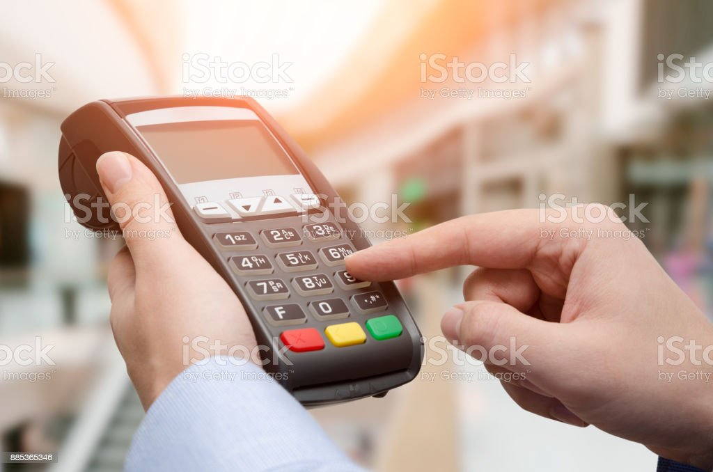 Hand using credit card payment machine stock photo