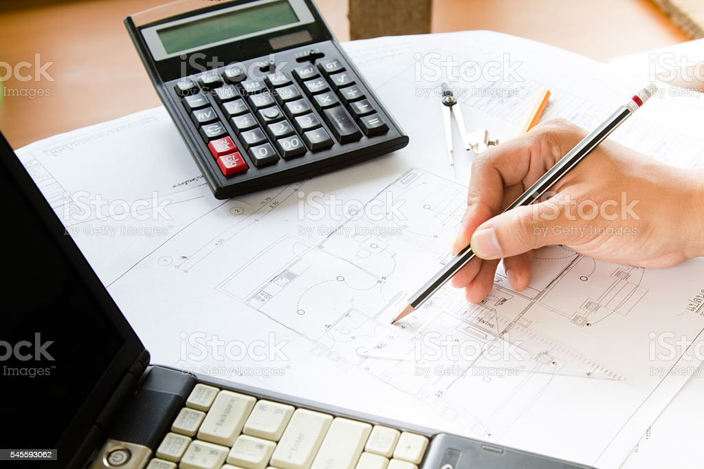 hand using dividers design room interior with blueprint stock photo