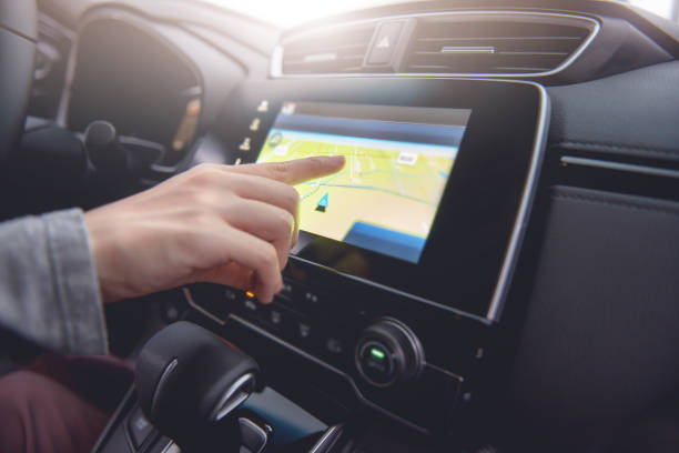 Hand using GPS navigation system in car while travel. Hand using GPS navigation system in car while travel. global positioning system stock pictures, royalty-free photos & images
