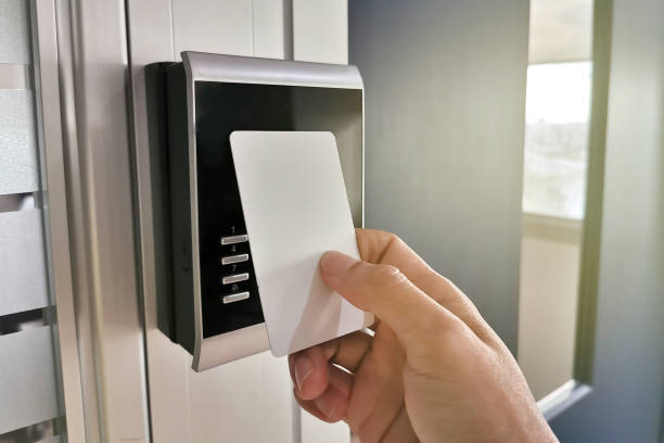 hand using key card;access control concept - accessibilità foto e immagini stock