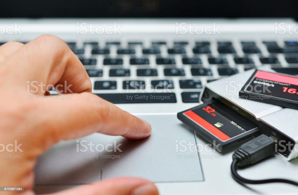 Hand using laptop computer,photographer concept stock photo
