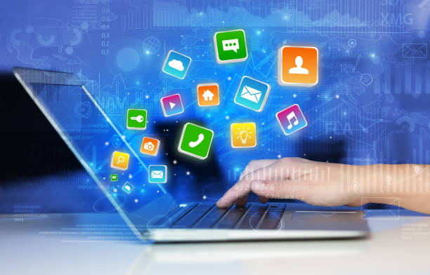 Hand using laptop with bouncing application graphs and report concept stock photo