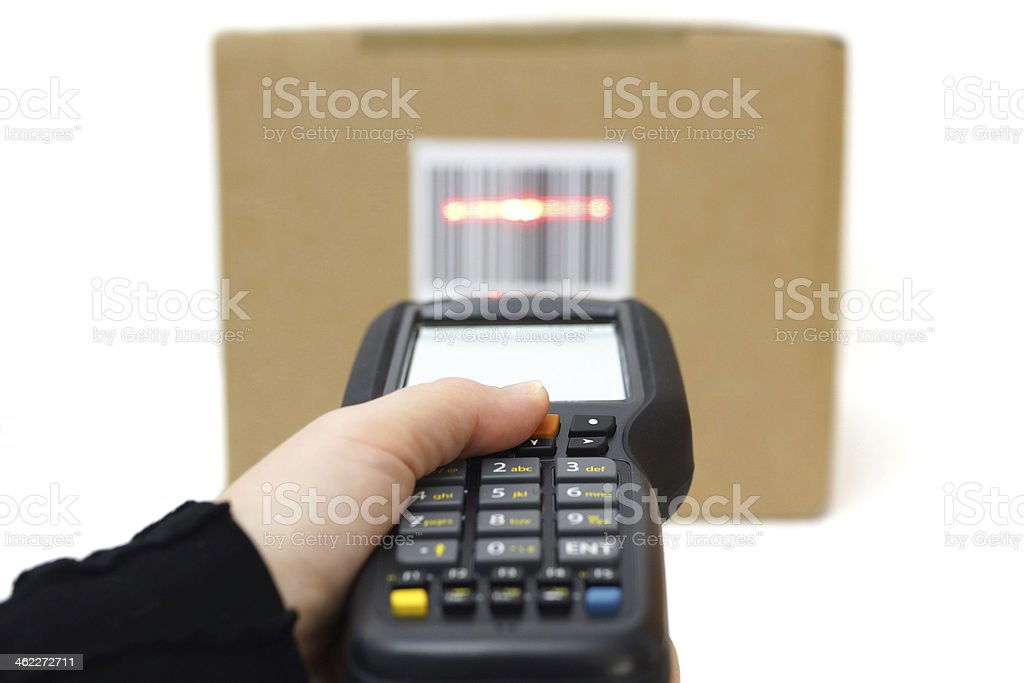 Hand using laser to scan bar code on box stock photo