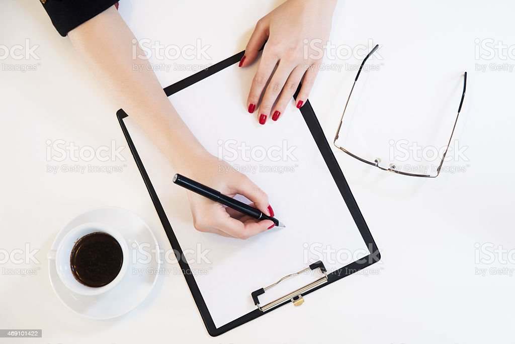 Hand using pencil writing on blank notebook. stock photo