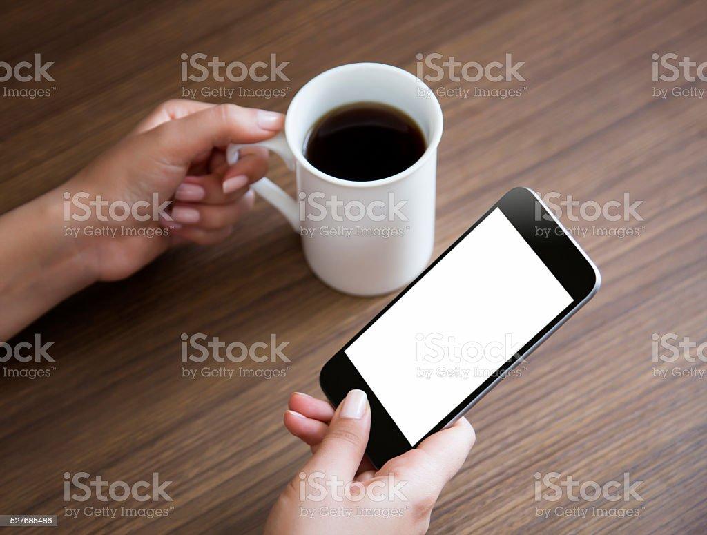 hand mit Smartphone auf dem weißen Bildschirm anzeigen – Foto