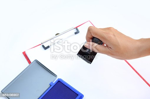 683496662 istock photo Hand using rubber stamper with blue Ink pad(box) on white paper. 683496902