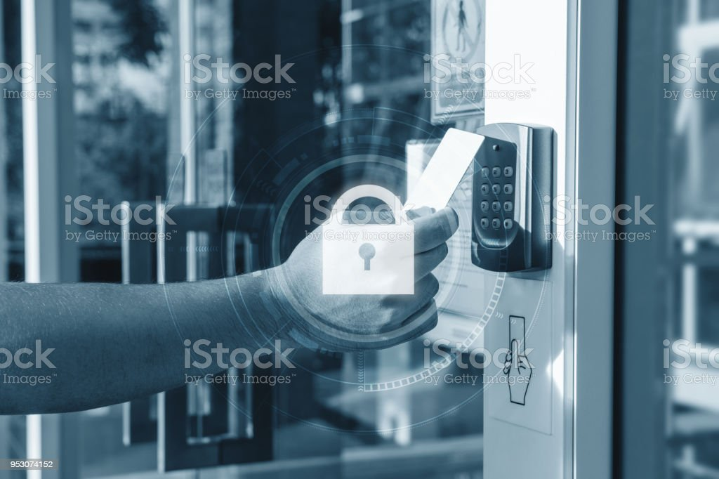 Hand using security key card scanning open the door to entering private building with lock icon technology. Home and building security system stock photo