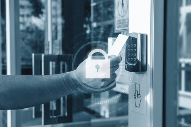 Hand using security key card scanning open the door to entering private building with lock icon technology. Home and building security system Hand using security key card scanning open the door to entering private building with lock icon technology. Home and building security system security pass stock pictures, royalty-free photos & images