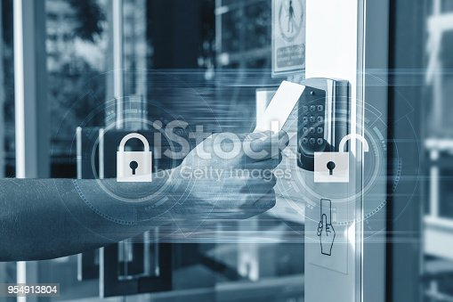istock Hand using security key card unlocking the door to entering private building . Home and building security system 954913804
