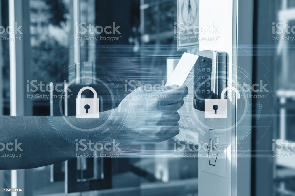 Hand using security key card unlocking the door to entering private building . Home and building security system stock photo