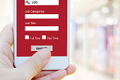 istock Hand using smart phone searching job online on screen device, business and technology concept 854818412