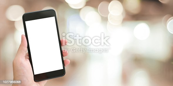 istock Hand using smart phone with blank screen over blur bokeh light background, business and technology, internet of things concept 1027956068