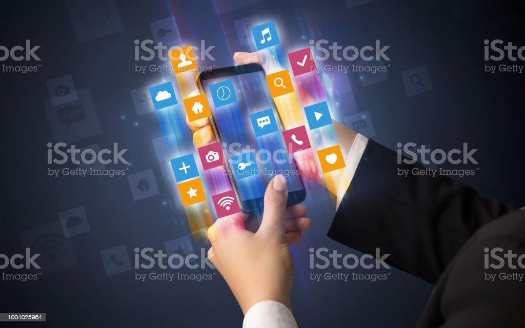 Hand using smartphone with angular app icons stock photo