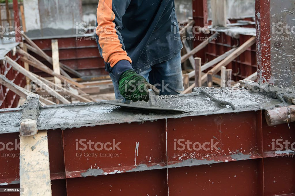 hand using smooth the cement screed with trowel stock photo