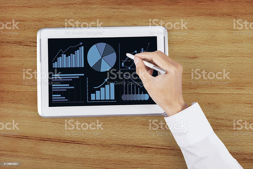 Hand using stylus pen on digital tablet 2 stock photo