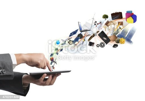 istock Hand using tablet with 3-D icons flying off screen 470231309