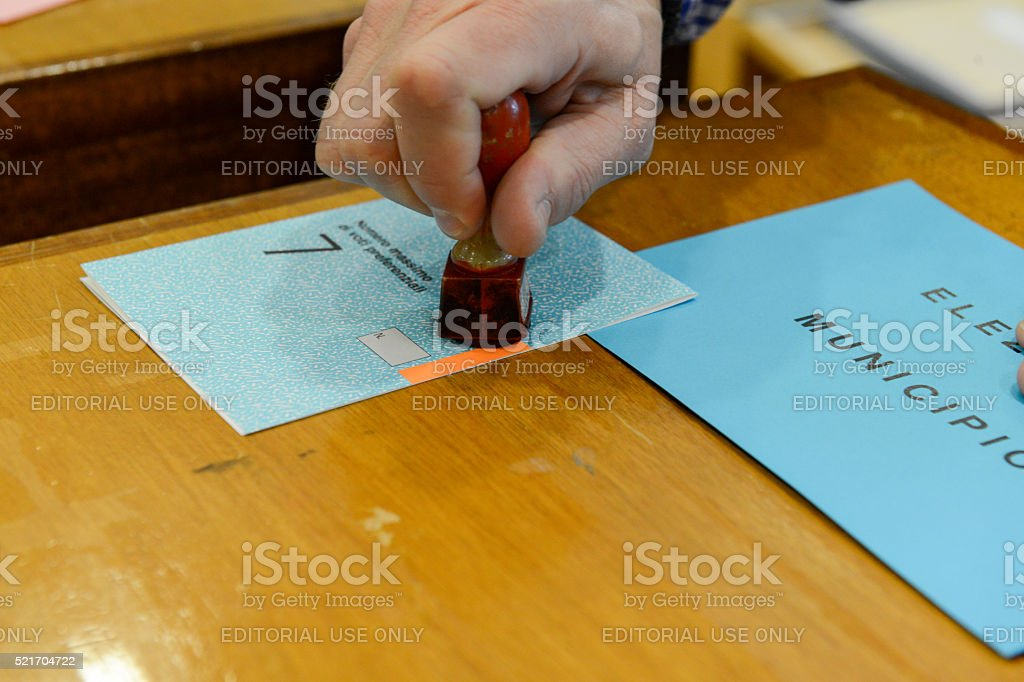 Hand  validating a voting ballot at the municipal election stock photo