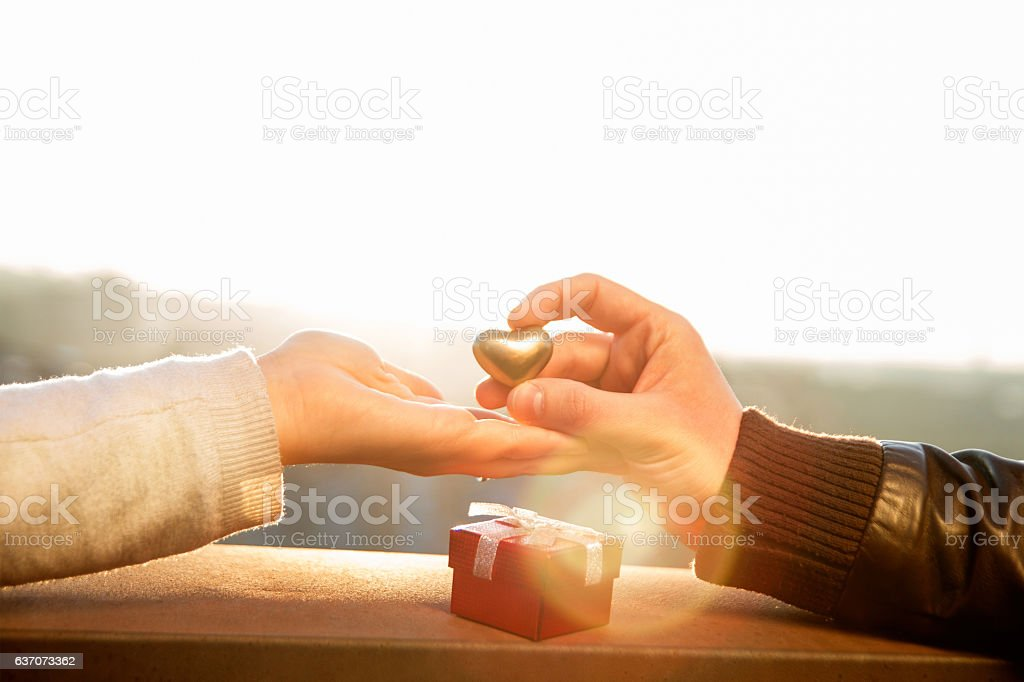Hand waiting a heart and man hand holding golden heart - foto de acervo