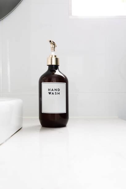 Hand Wash Dispenser In Luxury White Bathroom - Home Decor stock photo