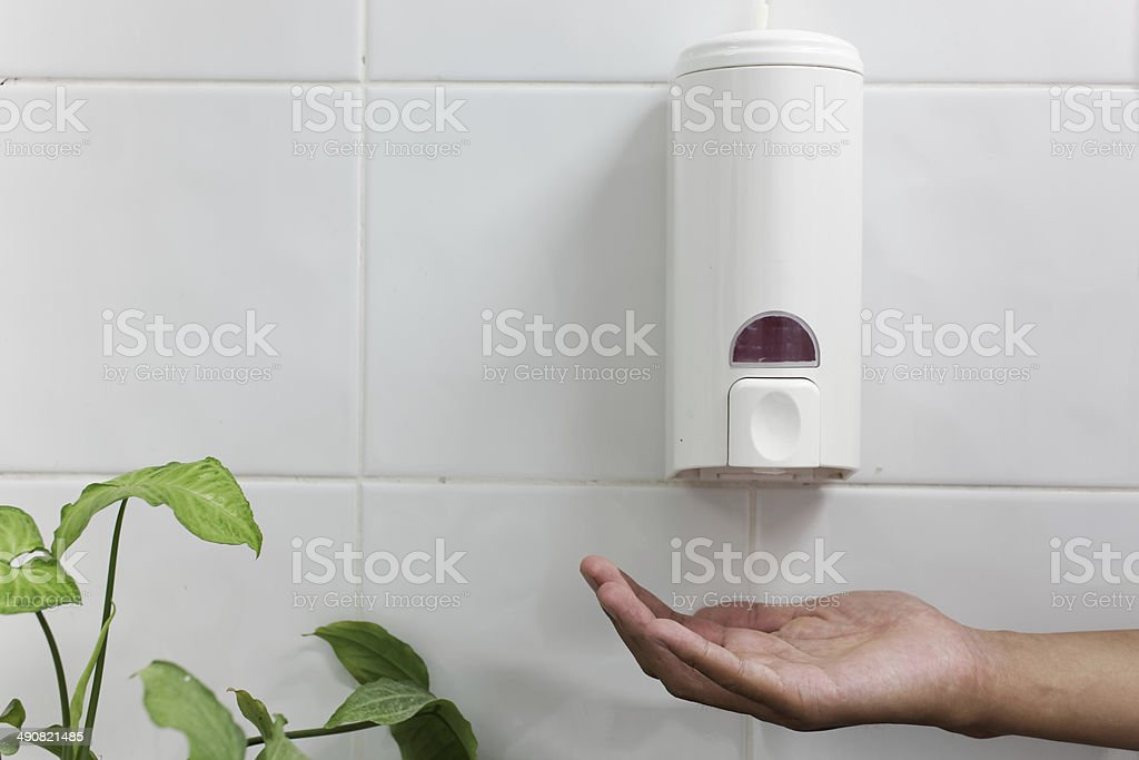 hand wash-Automatic soap dispenser stock photo