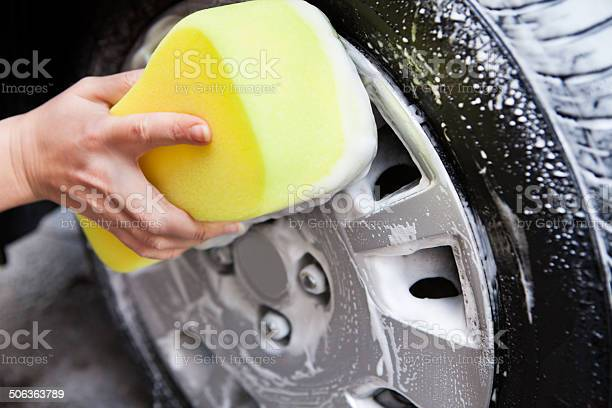 Hand Washing A Tire With Sponge Stock Photo - Download Image Now