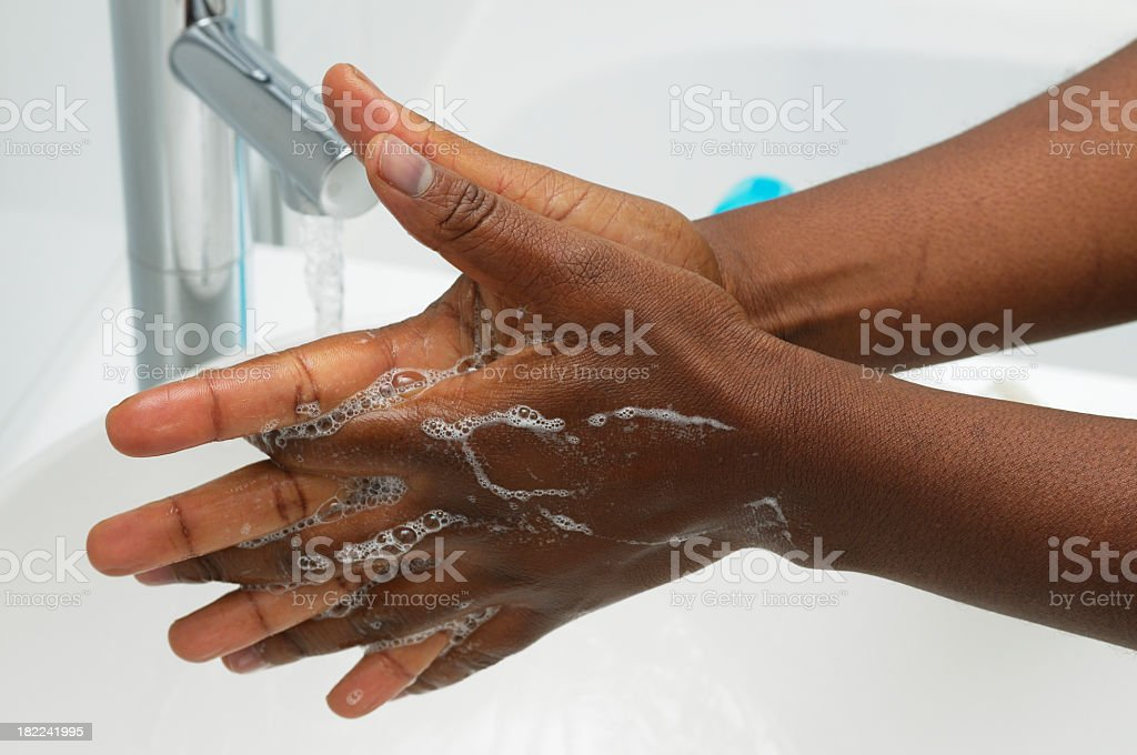 Hand Washing - Cleaning between the fingers stock photo