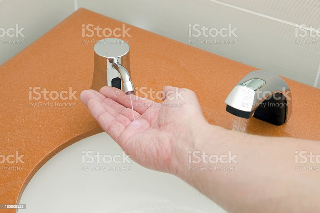 Hand Washing with Automatic Soap Dispenser and Running Faucet royalty-free stock photo