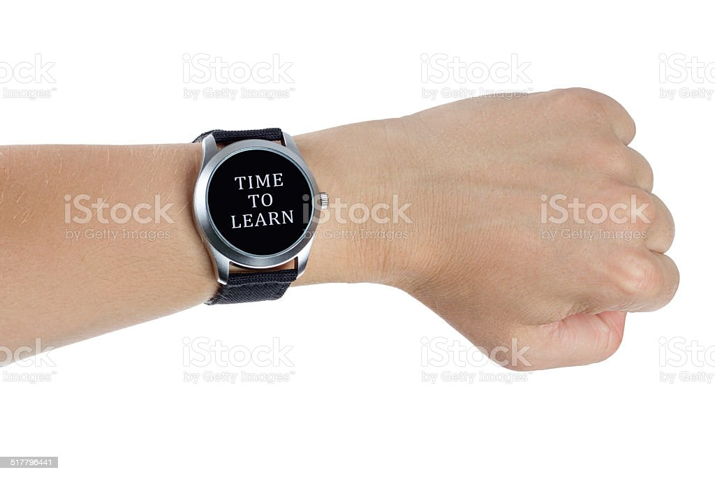 Hand wearing a black wrist watch. Time to learn concept stock photo