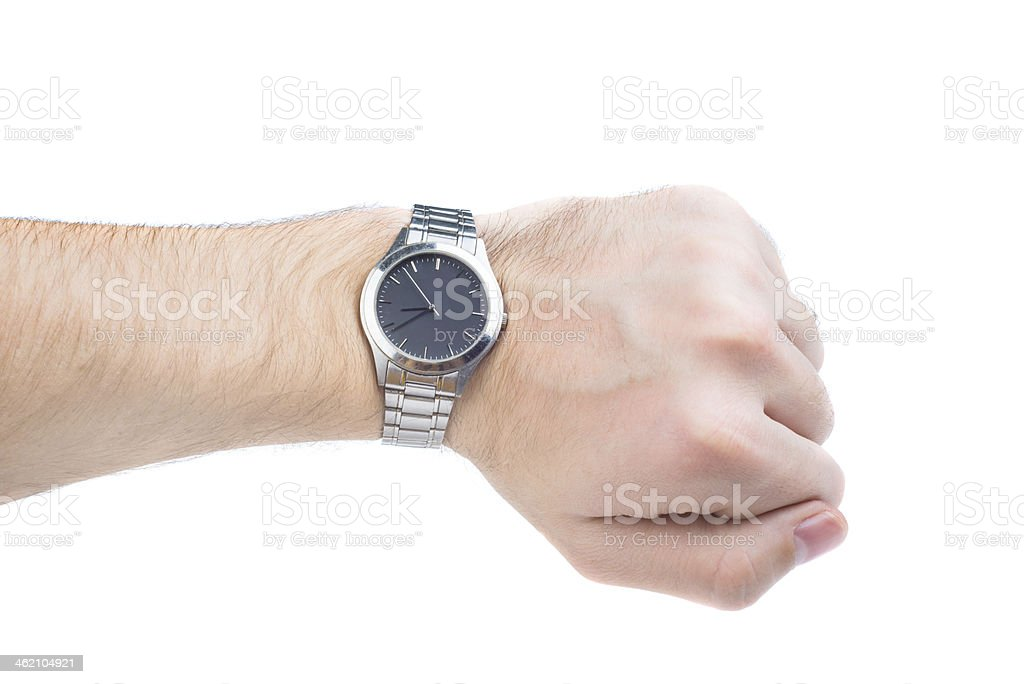 Hand wearing a silver and black watch over white background stock photo