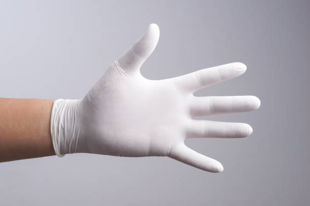 Hand wearing latex glove Hand wearing latex glove on white background surgical glove stock pictures, royalty-free photos & images