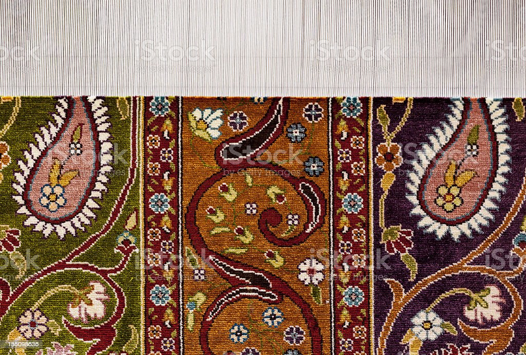 Hand weaving silk carpet royalty-free stock photo