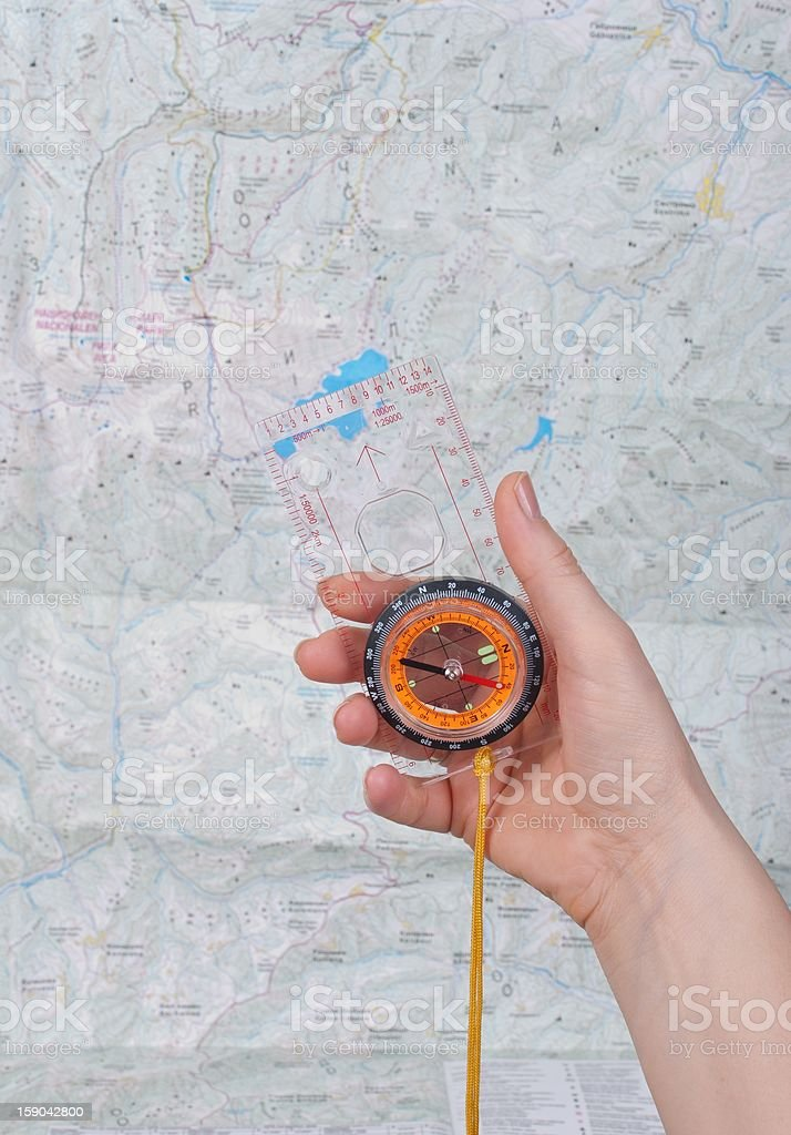 hand whit compas and map royalty-free stock photo